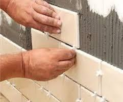 Posa piastrelle rivestimento pareti ristrutturazione